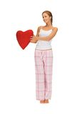 Woman in cotton pajamas with big heart Royalty Free Stock Images