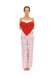 Woman in cotton pajamas with big heart Stock Photography