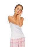 Woman in cotton pajamas with closed eyes Stock Photography