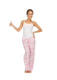 Woman in cotton pajamas showing thumbs up Royalty Free Stock Photos