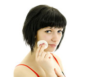 Woman with cotton swab cleaning her face. Royalty Free Stock Photography