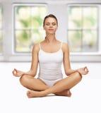 Woman in cotton underwear doing exercises Stock Photo