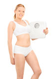 Woman in cotton underwear holding a weight scale Royalty Free Stock Photo