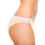 Woman in cotton underwear showing slimming concept Royalty Free Stock Photos