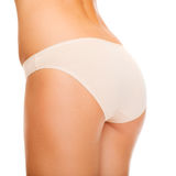 Woman in cotton underwear showing slimming concept Royalty Free Stock Images