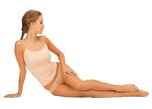 Woman in cotton underwear touching her legs Royalty Free Stock Image
