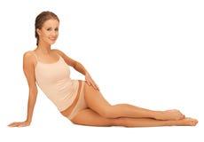 Woman in cotton underwear touching her legs Stock Photos