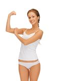 Woman in cotton undrewear flexing her biceps Royalty Free Stock Photos