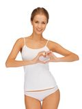 Woman in cotton undrewear forming heart shape Stock Photos