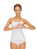 Woman in cotton undrewear forming heart shape Royalty Free Stock Image