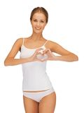 Woman in cotton undrewear forming heart shape Stock Photography