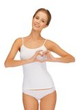 Woman in cotton undrewear forming heart shape Stock Image