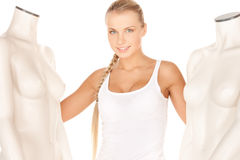 Woman in cotton undrewear with mannequins Stock Image
