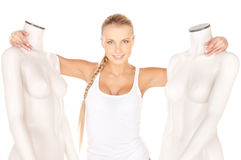 Woman in cotton undrewear with mannequins Royalty Free Stock Photo