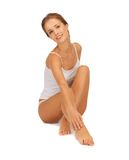 Woman in cotton undrewear touching her legs Stock Photo