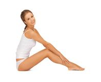 Woman in cotton undrewear touching her legs Stock Photography