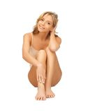Woman in cotton undrewear touching her legs Royalty Free Stock Photo