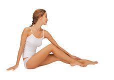Woman in cotton undrewear touching her legs Stock Photos