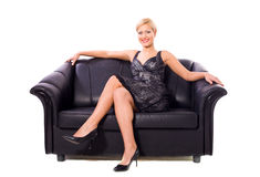 Woman on couch Stock Images