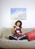 Woman on a couch Stock Photo