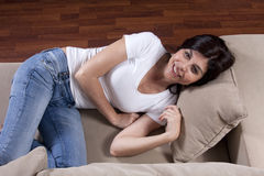 Woman on couch Royalty Free Stock Images