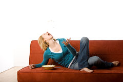 Woman on couch Stock Photography