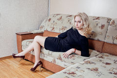 Woman on couch stock photo