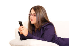 Woman on couch. With mobile phone Stock Photos