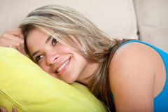 Woman on the couch Royalty Free Stock Photos