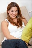 Woman on the couch Stock Photography
