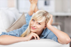 Woman on couch Stock Image