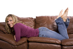 Woman on couch feet up Royalty Free Stock Photo