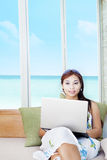 Woman on couch with laptop Royalty Free Stock Photo