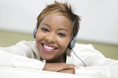 Woman on couch Listening to Headphones portrait close up Stock Photos