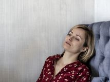 Woman on the couch in the room. royalty free stock photo