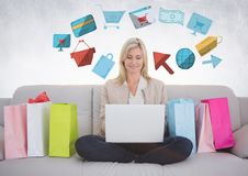 Woman on couch with shopping bags and online shopping graphic drawings Royalty Free Stock Photos