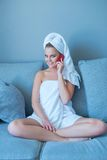 Woman on Couch Talking Through Phone After Bath Royalty Free Stock Images