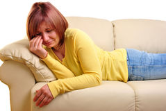 woman  on the couch and unhappy Stock Image