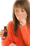 Woman with cough syrup stock image