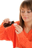 Woman with cough syrup stock photography