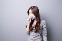 A Woman coughing with mask Royalty Free Stock Image
