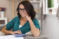 Woman counting bills Stock Photo