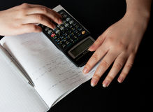 Woman counting with a calculator Royalty Free Stock Image