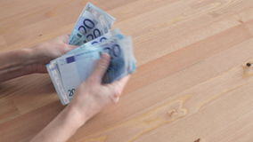 Woman counting Euros stock footage