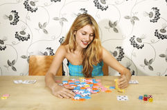 Woman Counting Gambling Chips Royalty Free Stock Image