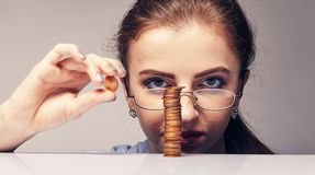 Woman counting her savings. Young attractive woman counting her savings money Royalty Free Stock Photo