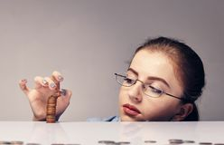 Woman counting her savings. Young attractive woman counting her savings money Stock Photo