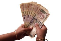 Woman counting indian rupees Stock Images