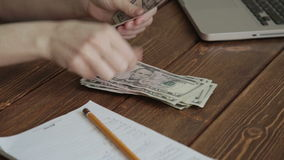 Woman counting money on the desk stock video footage