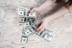 Woman counting money Stock Photos